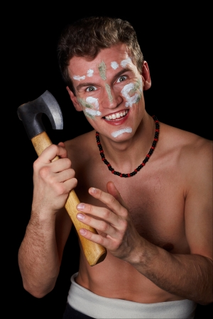 The smiling man POPOV DMITRY in a necklace holds an axe, a black background