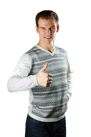 The man in a white sweater with a figure shows okey gesture a white background