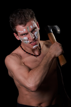 The aggressive white man with an axe in hands, a fighting coloring of Indians (stylization) and a necklace, a black background
