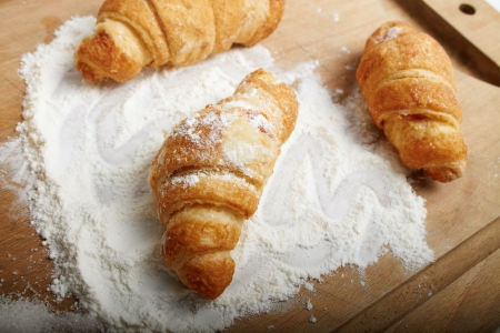 Three croissants on a wooden board