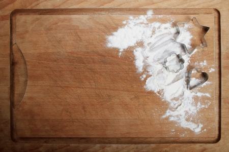 The form for cookies on the wooden board poured by a flour Stock Photo
