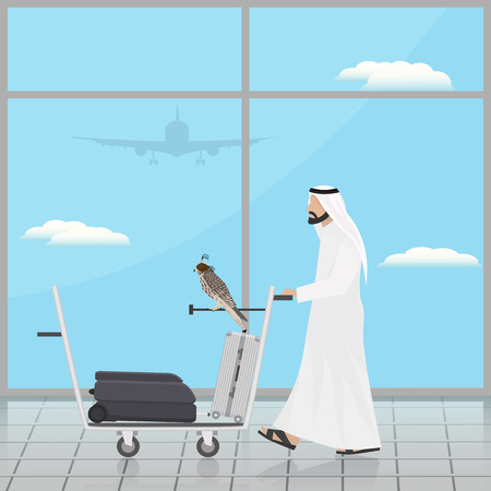 Arab with a falcon on a trolley at the airport