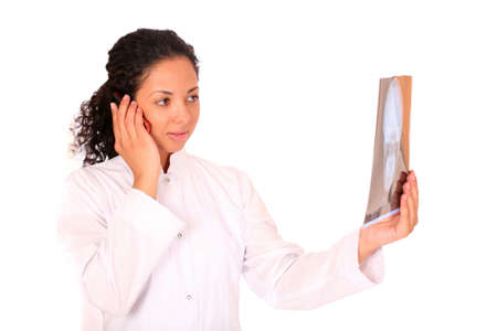 smiling doctor with an x-ray calling by phone over white background