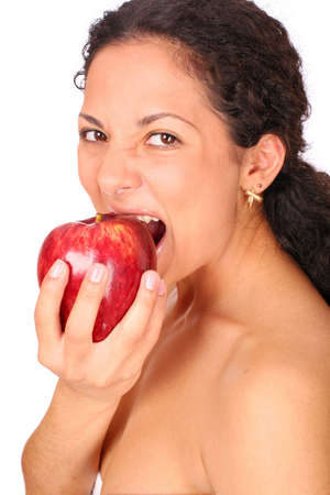 A woman eats red apple, standing on white background. photo