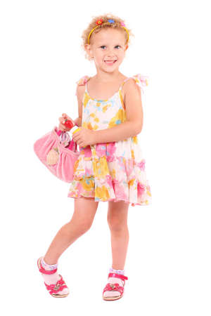 a little girl with a handbag over white background photo