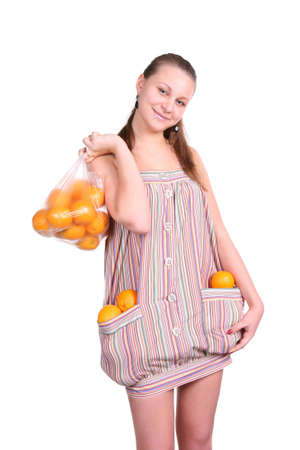 Smiling woman holds many oranges over white background Stock Photo - 4870599