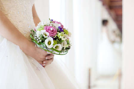 Bride holds a beautiful wedding bouquet.  Stock Photo