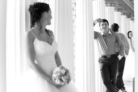 Happy groom is looking at camera