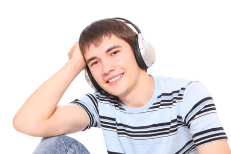 Man is listening to the music over white background photo
