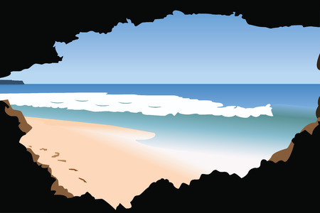 In-cave view of a sandy beach and sea