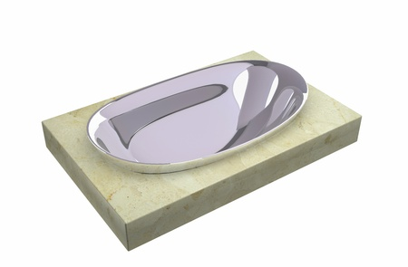 Chrome soap holder sitting on a granite slab, isolated against a white background. photo