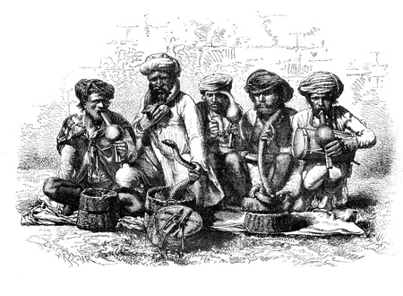 dangerous man: Snake charmers of India. - Drawing Sellier, vintage engraved illustration. Magasin Pittoresque 1875. Stock Photo