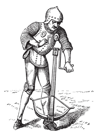 crossbow: A medieval crossbowman soldier vintage engraving. Old engraved illustration of a crossbowman cranking his crossbow.