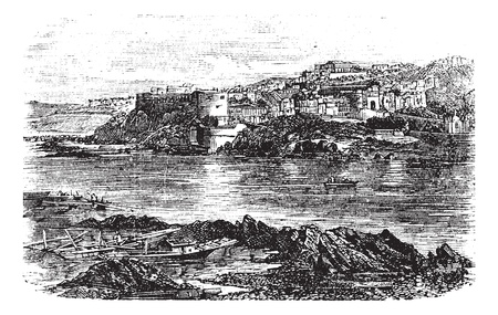 river bank: Attock or Campbellpur, Punjab, Pakistan. Vintage engraving. Old engraved illustration of Attock city located in the northern border of the Punjab of Pakistan and the headquarters of Attock District. Illustration