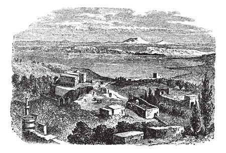 Sea of Galilee or Lake of Gennesaret or Kinneret or Lake Tiberias, in Israel, during the 1890s, vintage engraving. Old engraved illustration of Sea of Galilee with buildings in front.  Vector