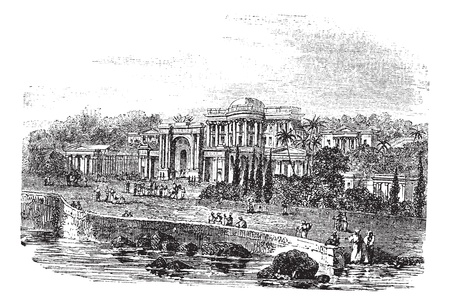 residency: British Residency or Koti Residency in Hyderabad, India, during the 1890s, vintage engraving. Old engraved illustration of British Residency with lake, trees and people in front.