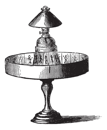 Praxinoscope, vintage engraving. Old engraved illustration of Praxinoscope isolated on a white background.