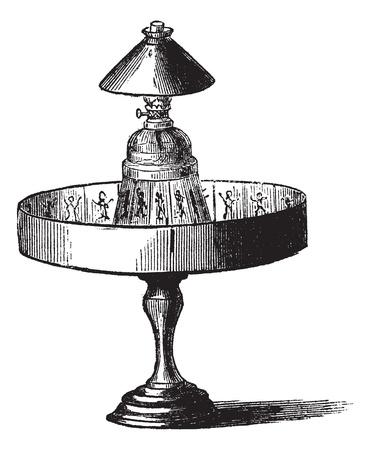Praxinoscope, vintage graveren. Oude gegraveerde illustratie van Praxinoscope geïsoleerd op een witte achtergrond.