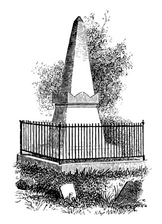 An obelisk-shaped marker engraved
