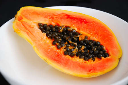 papaw: Papaya in white bowl Stock Photo