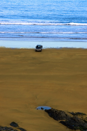 unattended: car on beach left unattended