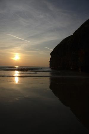kerry: lone surfer against irish cliffs