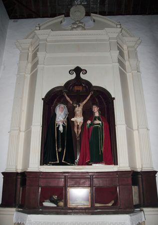 inri: icons within the confines of a village church Stock Photo