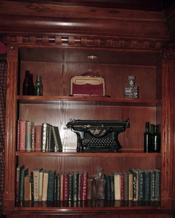 poems: some shelves full of antique bits and bobs