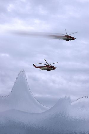 two helicopters on a life rescue mission photo