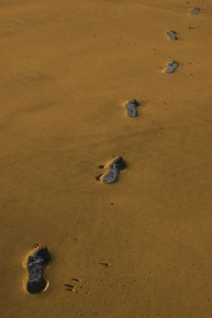 carbon footprint tracks on a beach in ireland