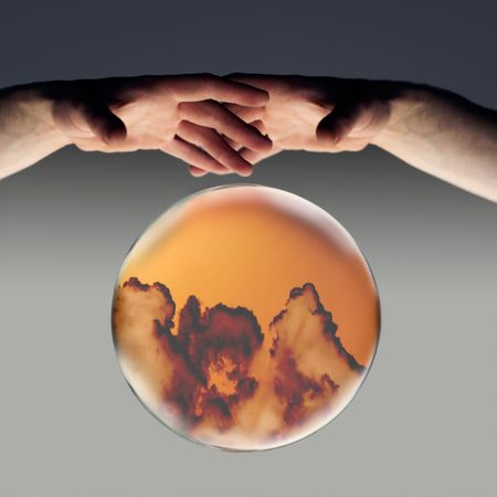 crystal ball showing dark clouds on the horizon with a clipping path photo