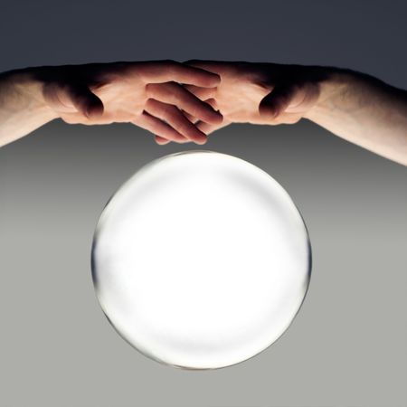 hands over a crystal ball of fortune with a clipping path  photo