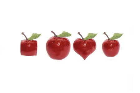 four red apples of various shapes on a white background with rain drops and love hearts with clipping path photo
