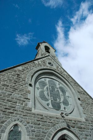 the front face of an irish church with a blue sky background Stock Photo - 3114274
