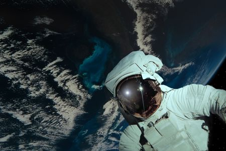 a simple background of the earth and stars as viewed by a space man from our own universe