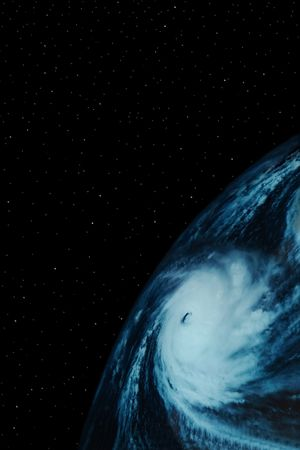 severe weather: a simple background of the earth and stars at night in the sky of our own universe with a severe  weather system in progress