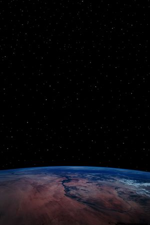 a simple background of the earth and stars at night in the sky of our own universe Stock Photo - 3160134