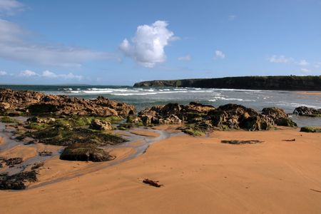 a rocky beach on a warm day with a calm sea an ideal place to have a walk in ireland photo