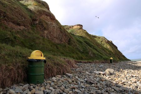 a rocky beach with rubbish bins on a warm day with a calm sea an ideal place to have a walk in ireland Stock Photo - 3331610