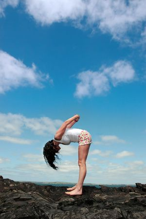 parsvakonasana: a beautiful woman doing yoga to show a healthy way to live a happy and relaxed lifestyle in a world full of stress Stock Photo
