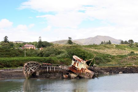 co cork: abandoned fishing boat in co cork ireland Stock Photo