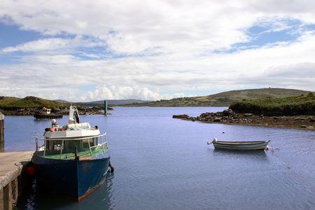 co cork: fishing boats in a bay in co cork in ireland
