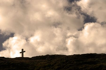 Cross on top of bear island in Ireland Stock Photo