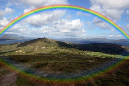 wet bear: the view from a hillside on Bear island county Cork Ireland on a wet day with rainbow in background