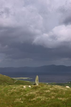 traditionally irish: an ancient stone marker on a hill on bear island on the west coast of ireland