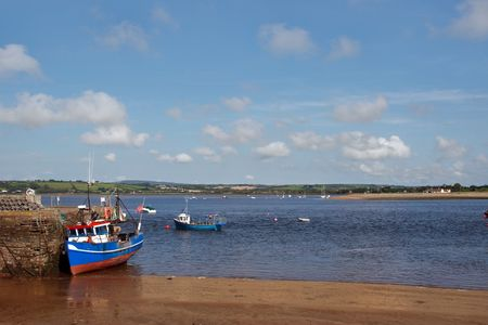 youghal: fishing boat on a dock in youghal harbor ireland