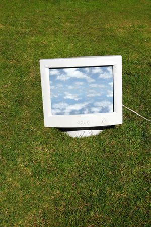 computer monitor on the grass depicting outsourcing photo