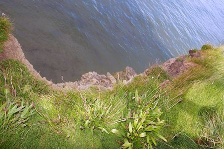 co  kerry: a view from the cliff edge down in ballybunion co kerry ireland Stock Photo