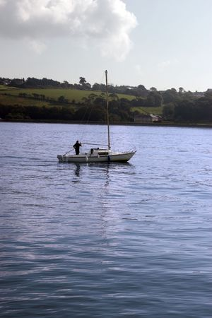 youghal: a yacht sailing in youghal bay ireland