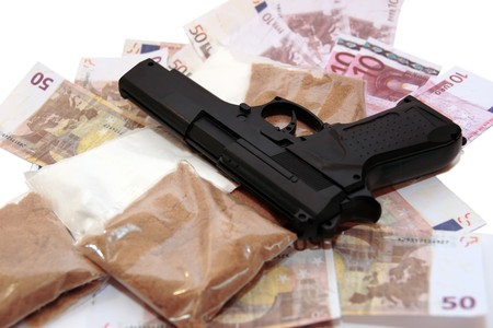stash: a stash of drugs gun and money showing a dangerous cost to life against a white background